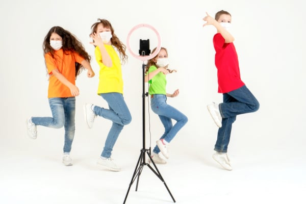 What do you do at a TikTok party 4 kids making a TikTok video in front of a phone camera with a ring light