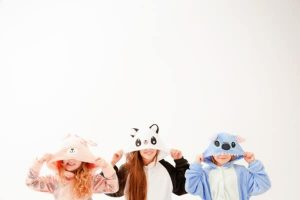 slumber party theme names and three young children dressed in different zoo animal theme pajamas