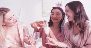 three women in cute pajamas drinking champagne at an easy bachelorette party
