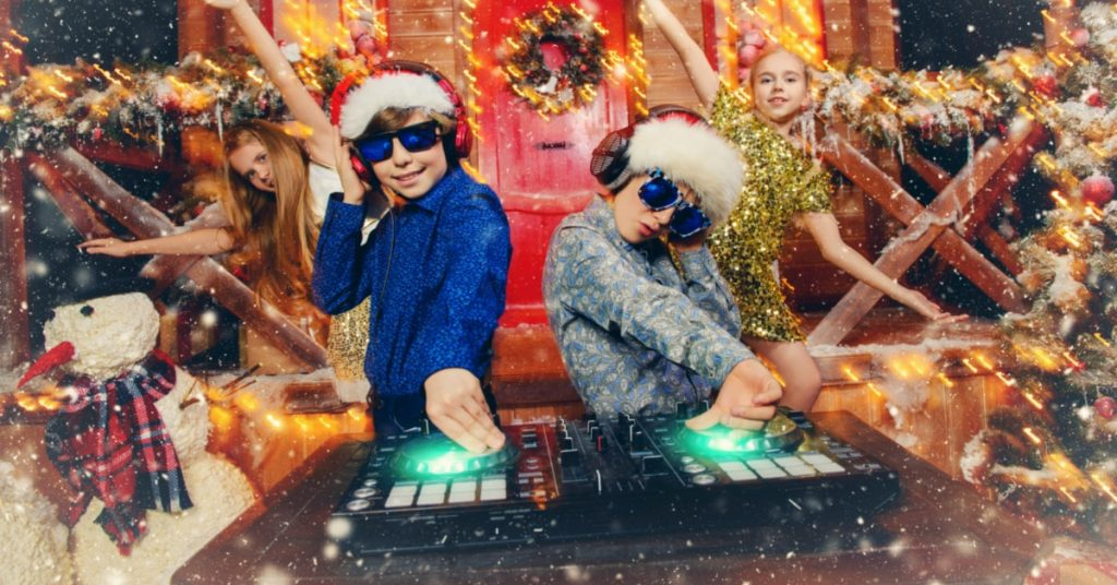 Children's Christmas party songs kids playing Christmas music on a DJ table