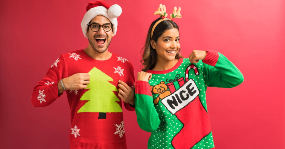 ideas for Christmas party themes man and woman in ugly christmas sweaters smiling